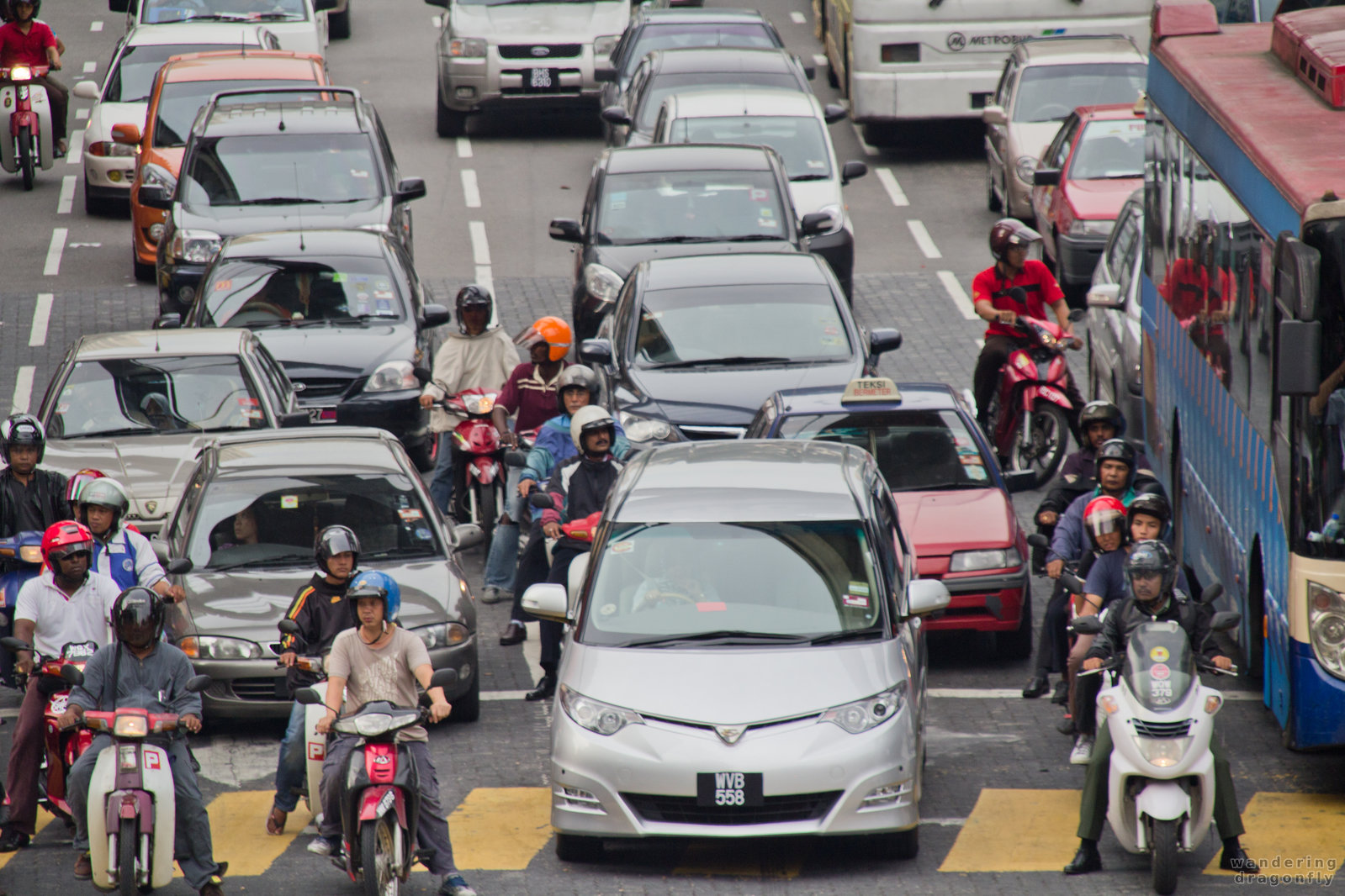 Lanes are for guidance only -- car, motorbike, traffic jam