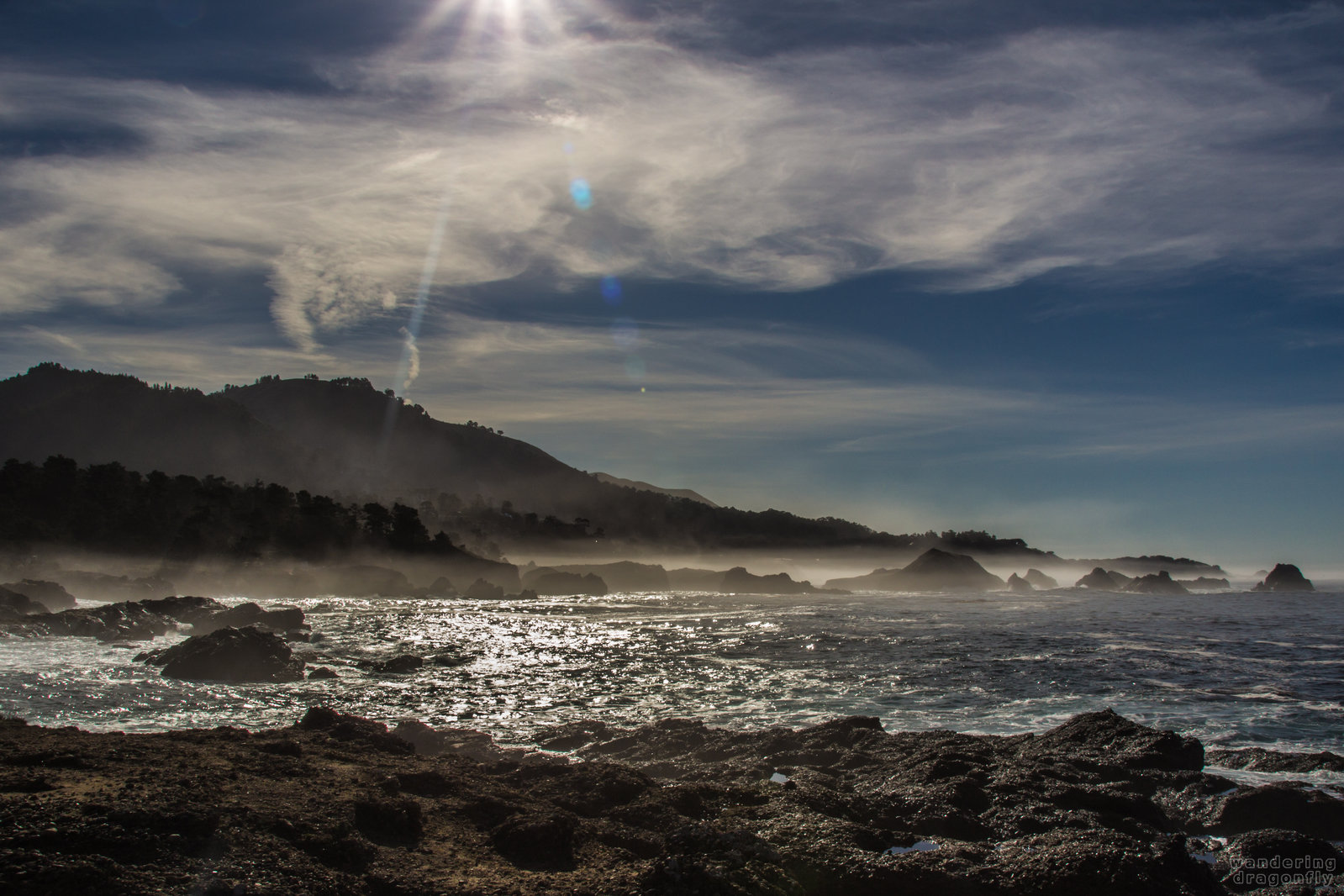 Gleaming coves -- cliff, cloud, cove, fog, ocean, rock, sky, sun beam, water