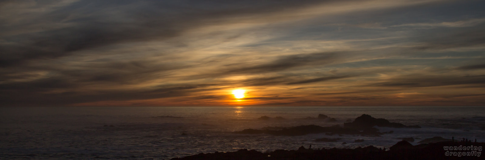 Transition from darkness to brightness -- cloud, ocean, rock, sun, sunset, water, wave