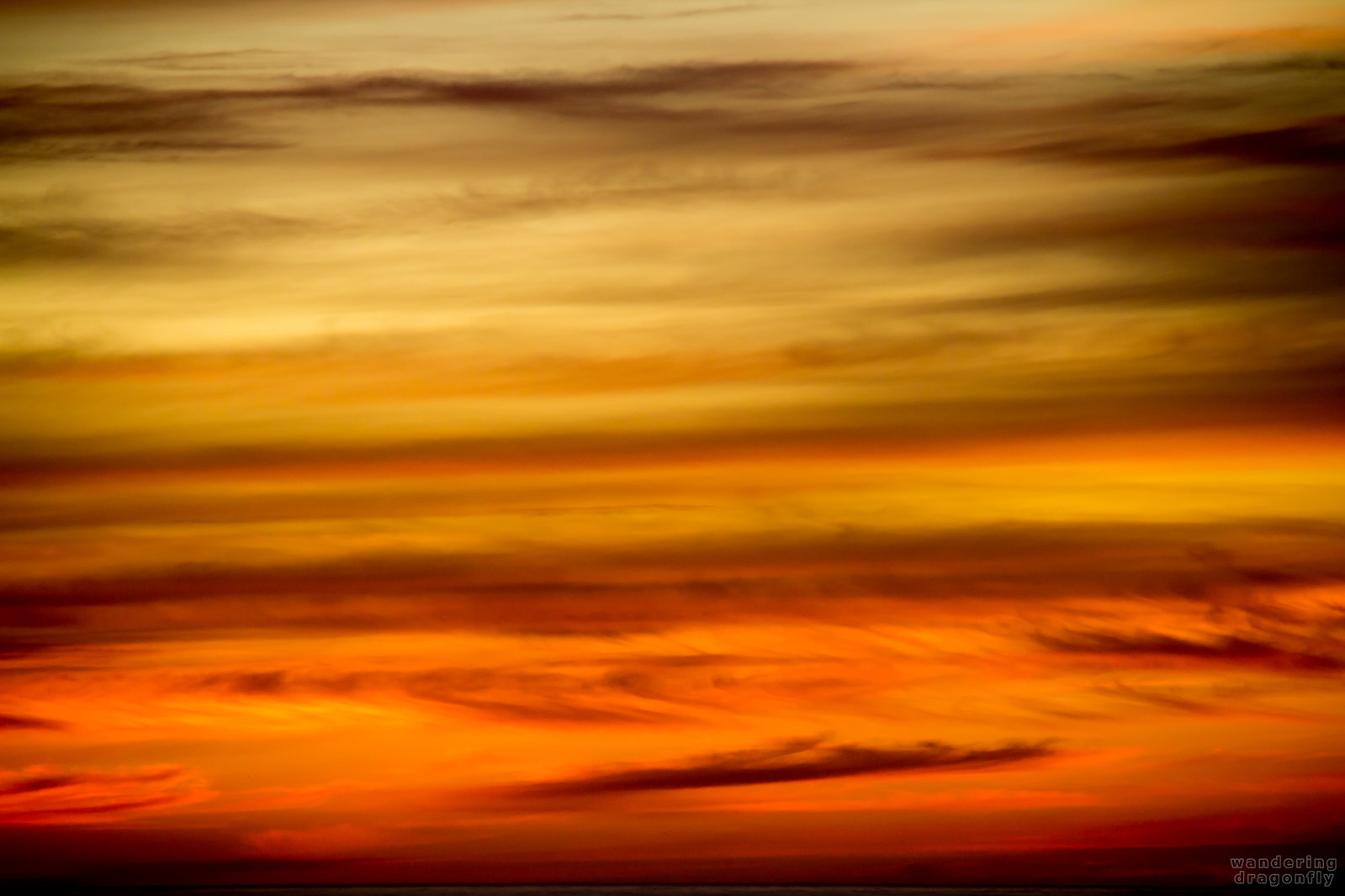 Sunset colors -- cloud, orange, red, stripes, sunset, yellow