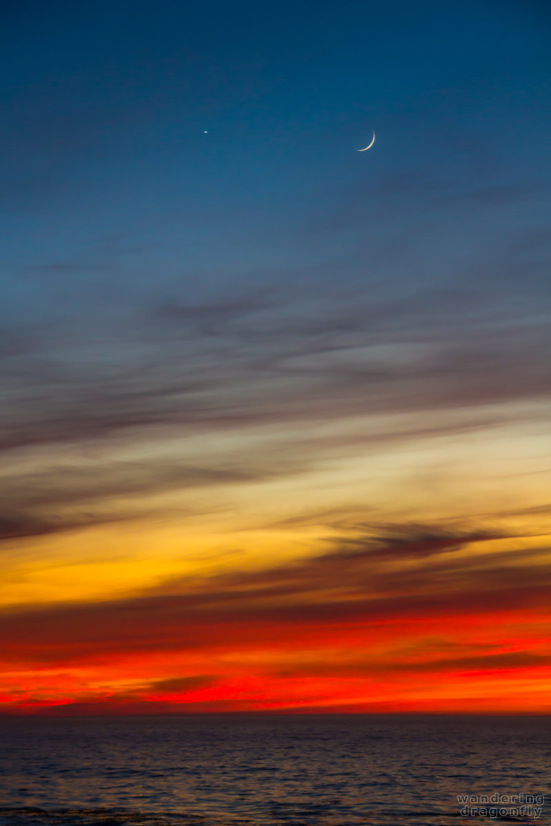Venus and Moon above the sunset at Point Lobos -- blue, cloud, moon, ocean, orange, purple, red, sunset, venus, water, yellow