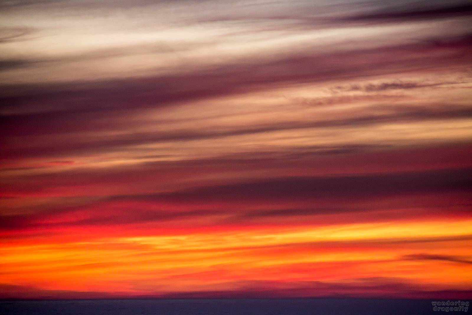Sunset colors -- orange, pink, purple, stripes, sunset, white, yellow