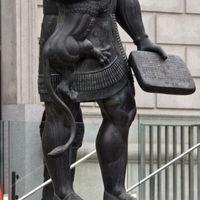 The statue of Ashurbanipal faces the San Francisco Library. He was an Assyrian king, who established the first systematically organized library in the ancient Middle East, the Library of Ashurbanipal, which survives in part today at Nineveh.