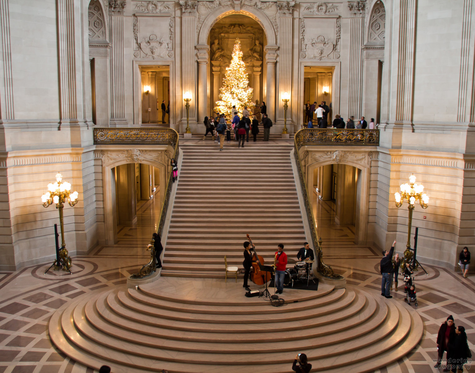 Rotunda of San Francisco City Hall -- christmas tree, lamp, people, playing music, stairs