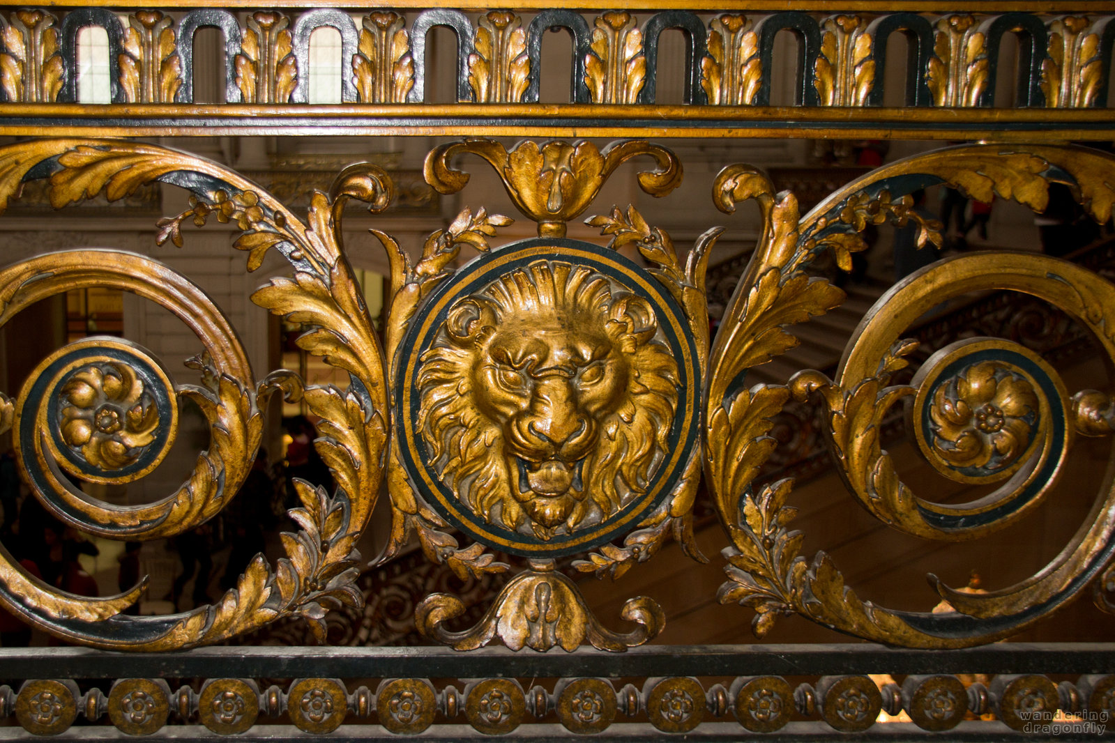 Carved parapet with lion head -- art, decoration