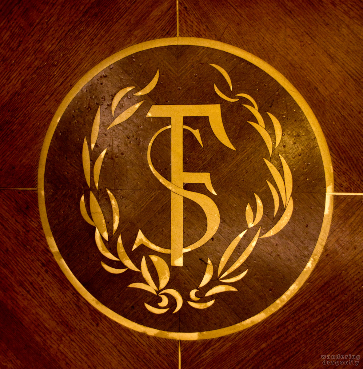 Inlay crest in the elevator -- art, decoration