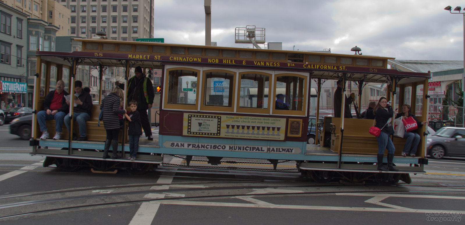 Cable car of California Street -- cable car, people, street