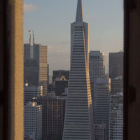 Picture of the Transamerica Pyramid through the window of Coit Tower