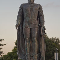 Cristoforo Colombo was born in 1451 in Genoa which is part of the present-day Italy. Although he wasn't the first explorer to reach the Americas, his four voyages across the Atlantic Ocean led to the first lasting European contact with the
