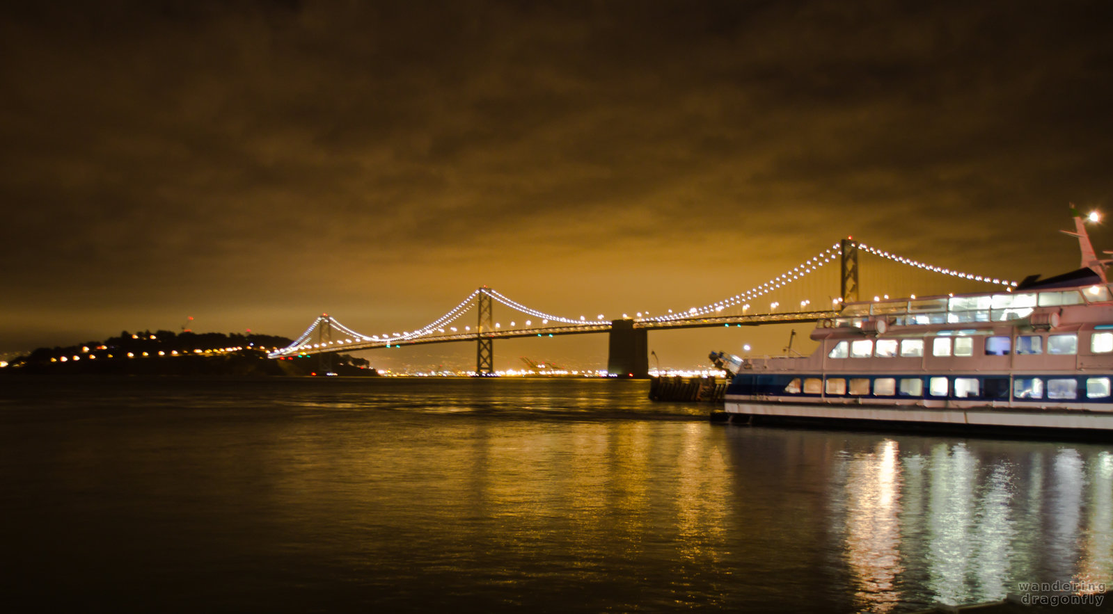 Ferry is preparing to leave -- bridge, night, ship, water